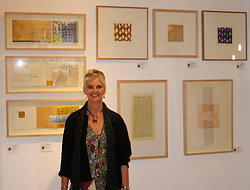 Carol MacDonald with her prints on exhibit at Galerie Maison Kasini